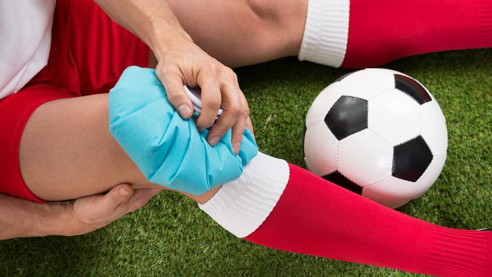 A player suffering leg injury